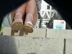 Girl with crossed legs sexy panty upskirt in the town AB17