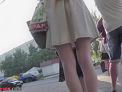 Bubble-ass redhead wears thong in upskirt porn