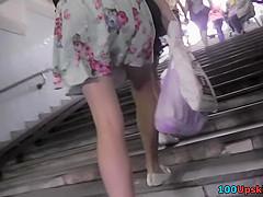 Upskirt thong footage of a firm-ass brunette with a bf