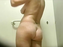 Beautiful and busty mature European milf in the shower room