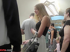 G-string upskirt clip of a blonde coming down on stairs