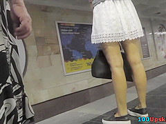 Auburn-haired gal shows off g-string in candid upskirts