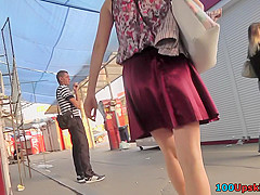 Amateur chick shows off g-string in candid upskirts