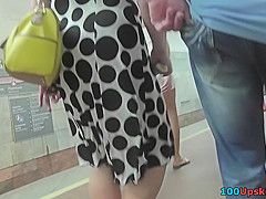 Blonde cougar's bubble butt seen in upskirts video