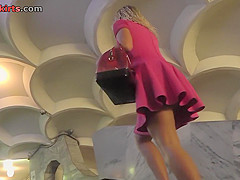 Candid upskirt porn with a blonde in a public place