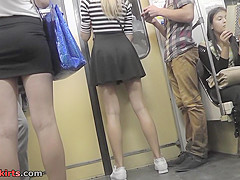 Hot upskirt porn with blonde slag in a public place