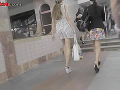 Candid upskirt mov shows a-line skirt on skinny ass