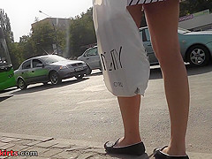 Bubble-ass gal wears classic panties in candid upskirts