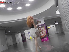 G-string of a red haired gal seen in free upskirt video