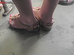 Upskirt porn with a slim blonde wearing tight g-string
