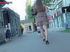 Amateur redhead shows off g-string in candid upskirts