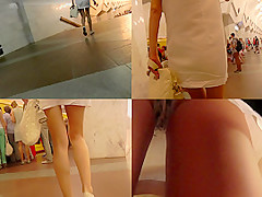 Tight mini skirt and funny panties in candid upskirt