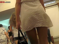 Upskirt video of an auburn-hair gal with g-string