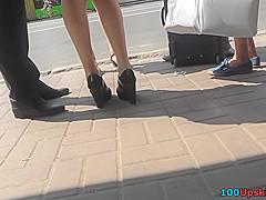 Upskirt g-string footage of a skinny ass brunette