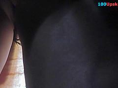 Voyeur upskirt video of a slim redhead's butt