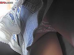 Upskirting voyeur filmed the bubble ass of a redhead