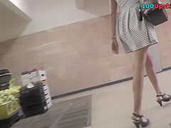 Upskirt video of an auburn-hair cougar with g-string