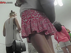 Thong-wearing gal with auburn hair stars in upskirt mov