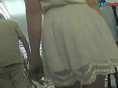 Hot g-string upskirt video of a slim brunette