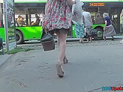 Hottie in g-string filmed by upskirting voyeur