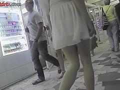 Hot upskirt g-string footage of brunette's flabby ass
