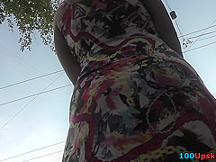 G-string wearing vixen filmed in upskirt video clip