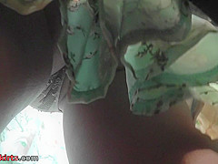Skinny ass and g-string of a brunette in upskirt mov