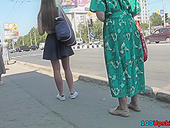 G-string wearing brunette filmed in upskirt video clip