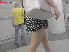 Upskirt video of brunette plumper's flabby ass