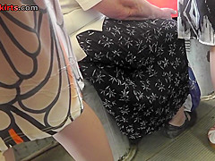 G-string upskirt shot of a chick in public transport