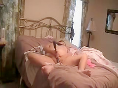 Hidden cam. My mum fingering on bed