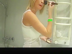 girl dancing in the bathroom in just her bra
