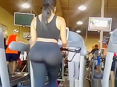 Big ass woman in tight sports pants at gym