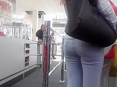 Woman squats exposing thong