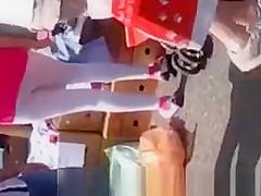 White leggings woman in flea market