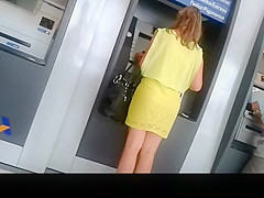Woman in see through yellow skirt