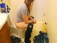 Chubby woman caught peeing in bathroom toilet