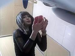 Asian woman takes a pee