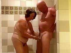 Chubby mature woman handjob in shower