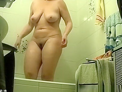 Chubby woman drying her wet pussy