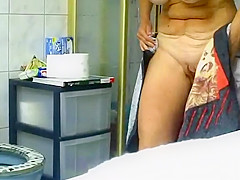 Mature woman spied in bathroom pissing and showering