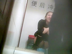 Two asian friends caught peeing