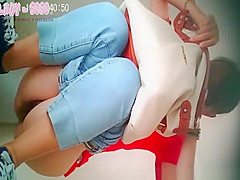 Asian woman in glasses squats and pees