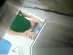 Spying blonde in toilet