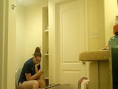 Chubby nerd girl in toilet