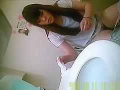 Asian women pissing in toilet