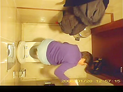 short hair mature woman taking a pee