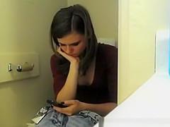Teen spied in toilet pissing