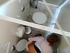 Hidden camera in public toilet ceiling
