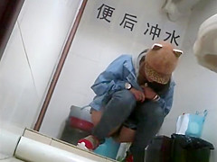 Asian girl with funny hat peeing